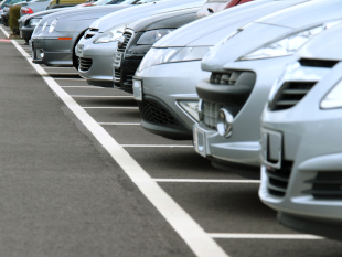 Image of cars parked in a car park.