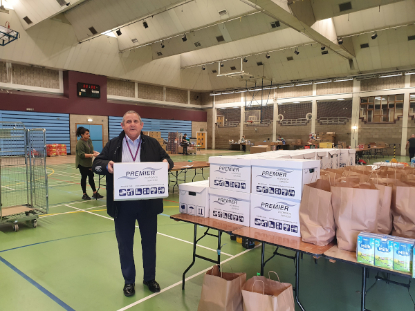 Image of Cllr Steve Curran at the Community Support Hub packing food and essentials.