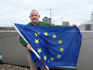 Image of Cllr Steve Curran,  Leader of Hounslow Council with the EU flag.
