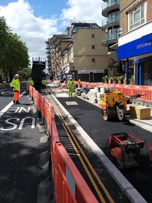 Image of a new cycle lane being laid by Hounslow Highways.