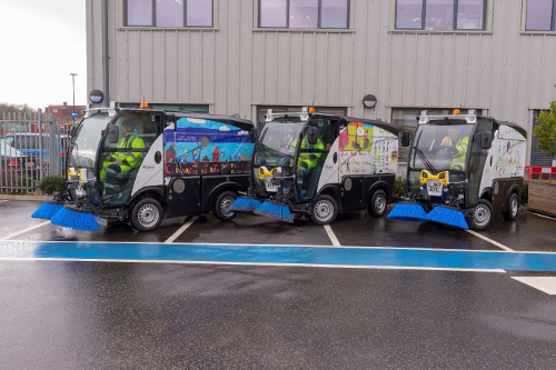 image of 3 new street sweepers with designs school children have made.