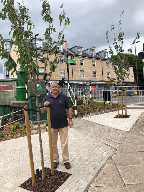 Image of Cllr Steve Curran at Brentford Bridge with newly planted cherry trees.