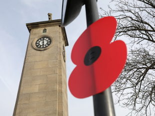 Image of a giant poppy on a lamp post near Isleworth War Memorial