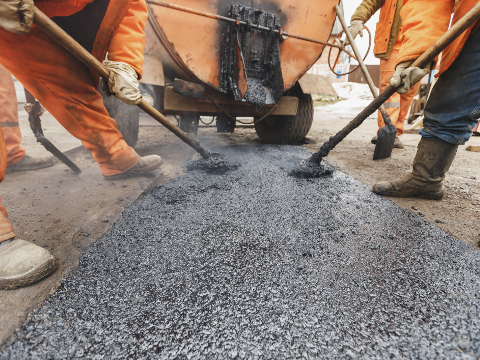 Image of workers laying tarmac