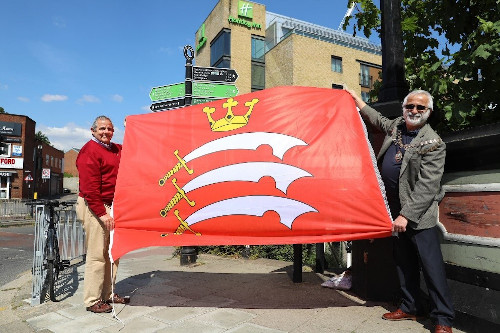 Image or Mayor of Hounslow, Tony Louki and Leader of Hounslow Council, Steve Curran holding up the Middlesex County Flag