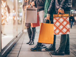 Image of shoppers with bags.