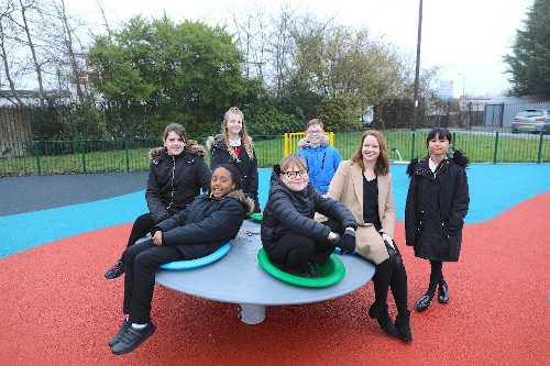 Mrs A Cella, Executive Headteacher, Sparrow Farm Junior School with her pupils in their new community playground.