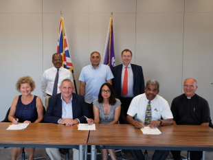 Image of the signing of the DHW over to EJJ