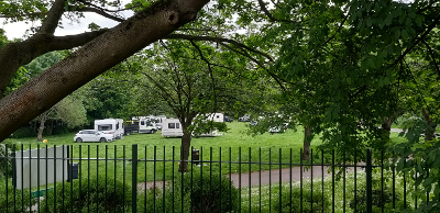 Image of traveller encampment on parks land.