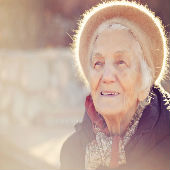 Elderly woman in the sunshine