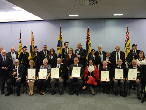 Group photo of all 7 Royal British Legion branches with their awards.
