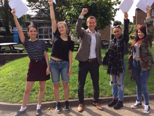 Top of the class again, jubilant GCSE students from Brentford School for Girls celebrate with Councillor Tom Bruce, Cabinet Member for Education, Children's Services and Youth Services, Hounslow Council.