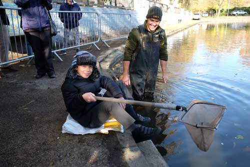Two of the Edward Pauling school kids putting carp into the pond this week.