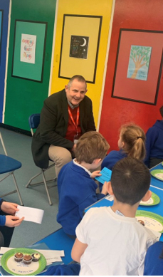 Councillor Curran pictured Being quizzed by the Grove Park Primary school council