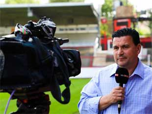 Mark Delvin in action reporting from Brentford Football Club