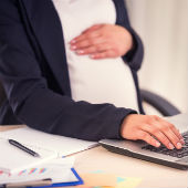 Pregnant woman at laptop