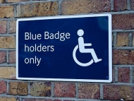 Image of a blue badge parking sign