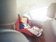Image of a child in a children's car seat