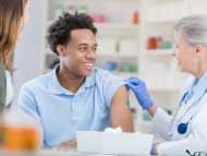 Image of a male receiving his flu vaccination.