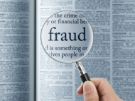 Image of magnifying glass highlighting the word fraud.