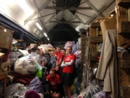 GoodGym runners help out at Friends of Cathja's charity shop.