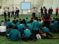 Image of pupils listening to a talk from the Police team at Junior Citizenship Week