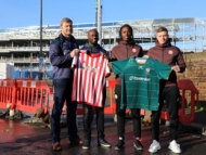 Image of London Irish RFC and Brentford FC players standing outside new Brentford Community Stadium