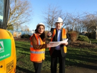 Image of Cllr Curran and Cllr Chaudhary at Redlees park discussing improvement plans.