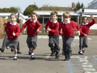 Image of primary school children playing in a school playground.