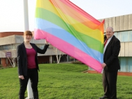 Image of Cllr Dunne and Cllr Eason raising the Rainbow flag for LGBT Pride month