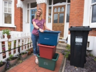 Image of Hounslow resident receiving her new recycling boxes.