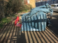 Image of dumped asbestos outside.