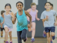 Children taking part in running exercise