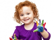 Image of a young girl with painted hands