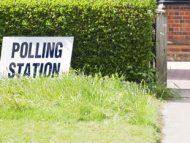 image of a polling station sign