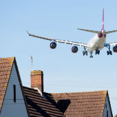 Low flying aircraft over houses