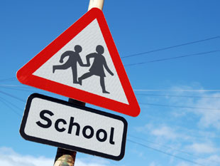 A picture of a school crossing sign