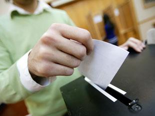 a person voting in the election