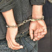 young person in handcuffs